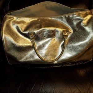 Michael Kors Gold Duffle bag